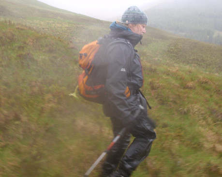Hillwalker in cloud and heavy rain - properly equipped for conditions