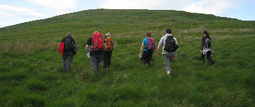 Group of walkers climbing Conic Hill near Loch Lomond