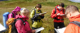 Group learning to navigate on a Mountaineering Scotland skills course
